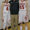 Coach Comer poses with Madison Shifflett and Lexi Dean