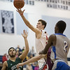 Logan Comer sails by William Monroe's Anthony Terry for a layup