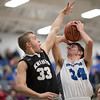 Cameron Irvine goes up for a shot against Nick Johns