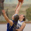 Casey Irvine and Catie Cramer reach for the jumpball