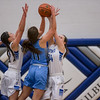 Addison Shenk and Addisen DeLucas come in to block a shot by Erika Reed