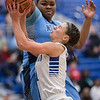 Haile McDonald attempts to block a shot from Addisen DeLucas