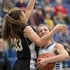 Brooke Vetter goes up for a shot against Eva Jordan