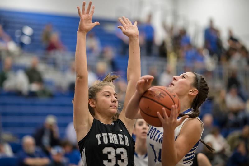 Addison DeLucas goes up for a shot against Eva Jordan