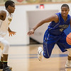 Elijah Mushagasha tries to cut in and drive to the basket