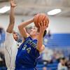 Cameron Irvine goes up under the basket