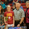 Jessica with her parents Claude and Melissa Lam of Elkton pose with BC Coach Jean Willi during pregame ceromonies.