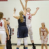 Lexi Dean and Laney Crobin battle for the jumpball