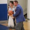 Coach Edwards congraulates Cameron Irvine on his 1,000 point