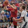 Austin Beaghan looks for teammate to pass to