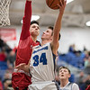 Cameron Irvine attempts a layup as Zach Hall attempts to block