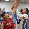 Logan Comer attempts tp block a shot by Angel Pacheco-Ortz