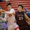 Zach Hall and Charles Gubler fight for a rebound
