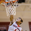 Javon Butler gets the dunks oner a Luray defendor