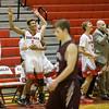 The ERHS bench erupts in cheers after a three point basket from senior Trenton Breeden