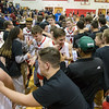 Eagle Squad congratulates ERHS' players as they exit the court after their semifinal conference win over Page