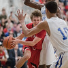 Chris Rogers pushes in to the lane  against Jarvis Vaughan (10) and Darius George (2) as he prepares to shove the ball out to Javon Butler