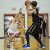 Logan Comer guards Luke Estep
