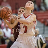 Meredith Dean powers up for a layup as she is fowled by Danielle Brenneman