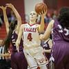 Madison Shifflett slides around Abby Rogers for a shot