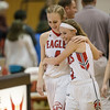 Madison Shifflett and Meredith Dean hug each other after the Eagles' win over Draft