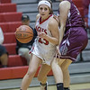 Natile Jenkens cuts around Bailey Tuner enroute to the basket