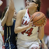 Naomi Gibson takes a look at a shot under the basket as Brittany Haney defends