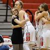 Madison Shifflett hugs Coach Hammer and Natile Jenkens hugs Meredith Dean as the seniors come out of their final regular season home game.