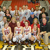Senior Basketball atheletes and their families pose for a picture midcourt