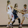 Meredith Dean attempts to stip the ball from Amber Wooldridge