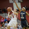 Haley Cave gets by Donyell Sloane for a layup