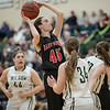 Lexi Dean finds a shot amoung a trio of Wilson players