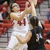 Naomi Gibson takes a shot under the basket over Payten Hicks