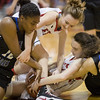 Lexi Dean, Meredith Dean, Alexiah Hall (12) and Kemper Snyder fight for a loose ball