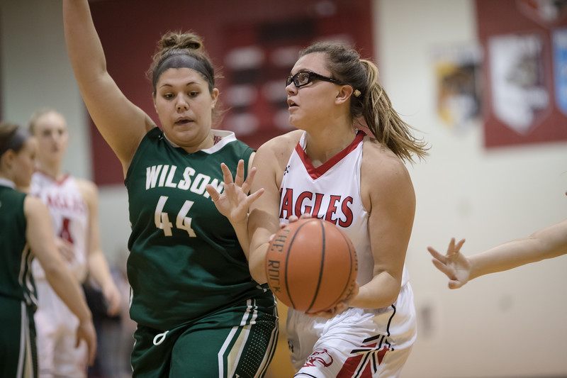 Naomi Gibson pushes forward in to the lane against a defending Sarah Sondrol