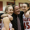 Madison Shifflett, Lexi Dean and Coach Comer celebrate after their win and clinching the Conference 36 title.