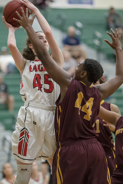 Lexi Dean takes a jumpshot over Deona Dowtin