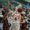 Madison Shifflett shoots around Micaila Coleman