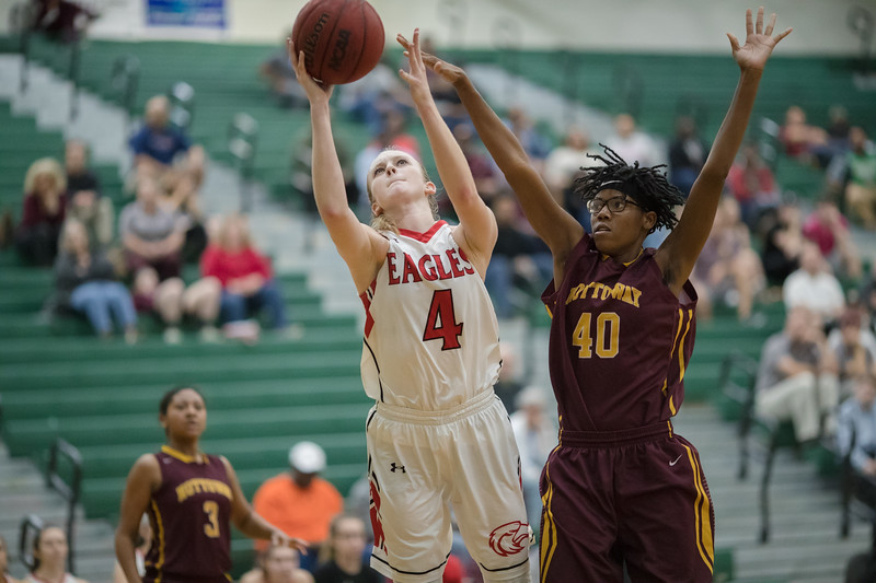 Madison Shifflett drives in past Richara Tillman for a shot.