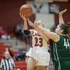 Natile Jenkins pulls in the fowl from Sarah Sondrol on a layup.