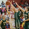Madison Shifflett powers her way up for a jumpshot against Cheridan Hatfield