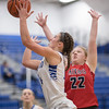 Addisen DeLucas goes for a layup against Quin Graves