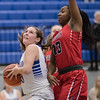 Blair McGloon looks at a shot as Alyanah Tyler-Cooper attempts to make a block