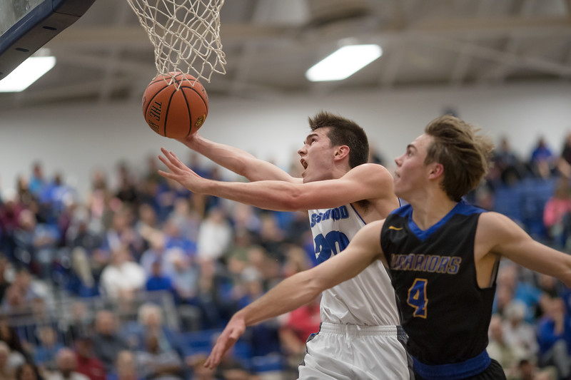 James Sullivan goes in for a layup against Ryan Ingram