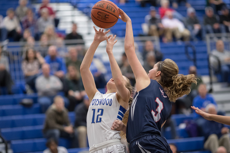 Constance Komara blocks a shot from Meredith Vetter but not before getting called on a fowl