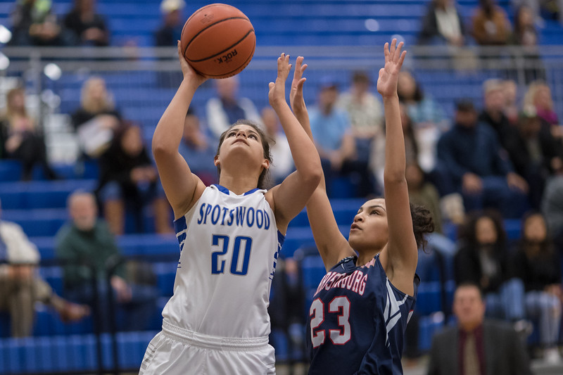 Chloe Brooks gets past Jakaya Brandon for a layup