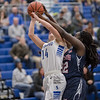 Addisen DeLucas fights her way up for a layup against Lene Andrawas.