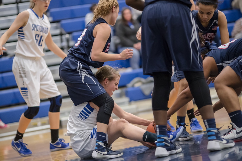 Brooke Vetter fights to regain a loose ball