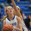 Stephanie Ouderkirk looks at a shot under the basket