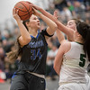 Addison Shenk goes for a layup around Sarah Wimer